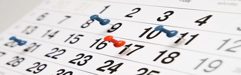 Calendar with thumbtacks.